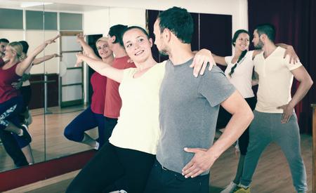 latino dance: Positive  couples dancing Latino dance in class