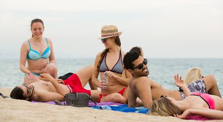 european people: Young european people sunbathing at the seaside