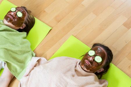 Meditating women wearing facial mask