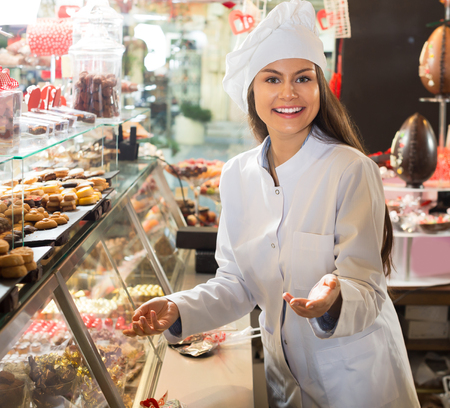 Young girl selling fine chocolates and sweet pastry