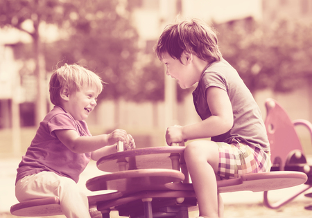 5s: Happy laughing children having fun at playground