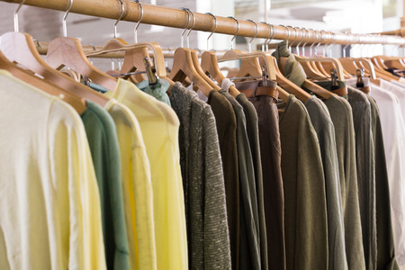 Assortment of warm clothing in modern garment store interior Stock Photo