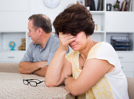 Sad woman experiencing family problems with partner indoors