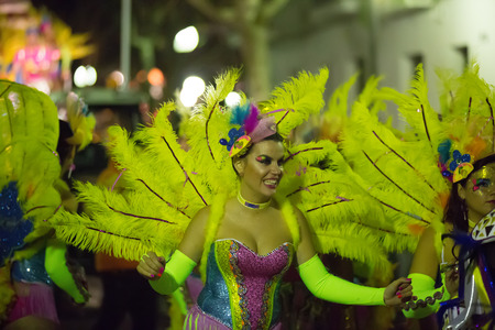 SITGES,  SPAIN - FEBRUARY 10, 2016:  Procession of Spanish Carnaval at Sitges in evening time. Catalonia, Spain Editorial