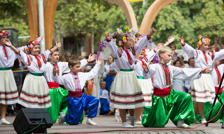 BARCELONA, SPAIN - SEPTEMBER 06, 2015: Ensemble of folk singing and dancing performing on stage at the Day of Ukrainian culture, Catalonia. Editorial