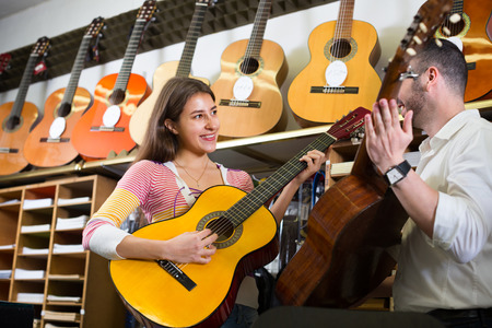 Portrait of ordinary customers in music instruments shop Stock Photo