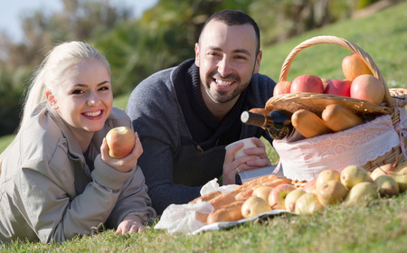 sandwitch: Portrait of young european  adults with apples and sandwitches in nature Stock Photo