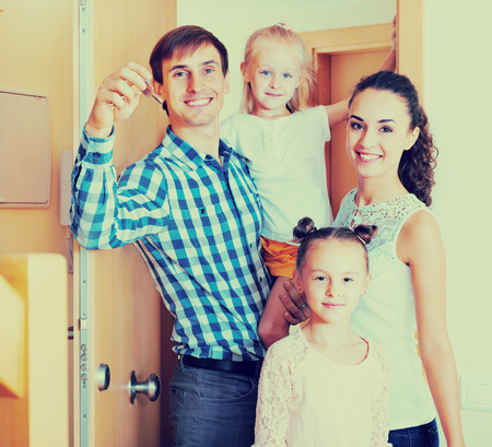 middle class: Ordinary middle class family moving in the new house