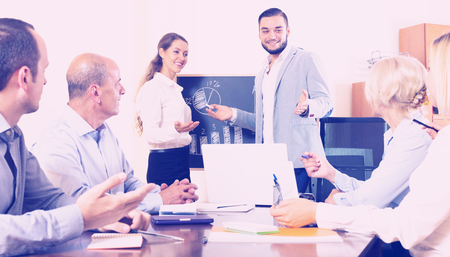successful male expert makes a presentation at a meeting in the office