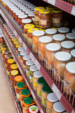 tinned goods: BARCELONA, SPAIN - FEBRUARY 02, 2016: Display with ordinary assortment of glass food products and pickles in East European food store