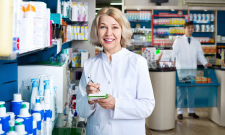 Portrait of two smiling pharmacists working in modern farmacy Stock Photo
