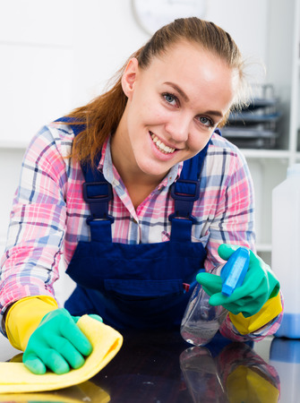 happy cleaner girl with chestnut hair working Stock Photo