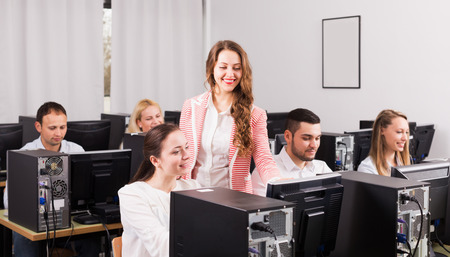 supervise: New open-space office with head and successful team. Focus on the left woman Stock Photo