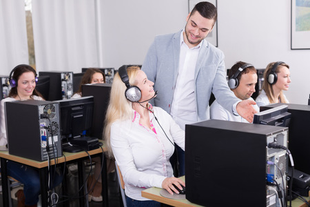supervise: boss and his successful call center team at office Stock Photo
