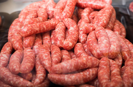 assort: sausage assort on counter in bakers shop, close up