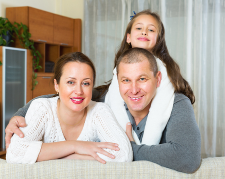 3 4 years: Happy family of three in domestic interior at home