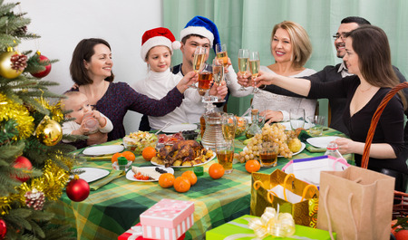 granny and grandad: Mature parents with happy adult kids and grandchildren celebrating Merry Christmas