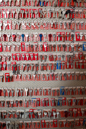 BARCELONA, SPAIN - MARCH 19, 2016: Many new draft keys hanging in the row in the workshop