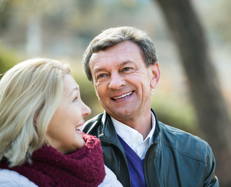 Happy mature couple enjoying spending time outdoors at spring