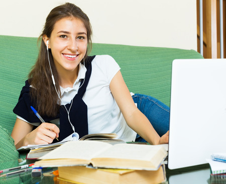Young woman college student study at home