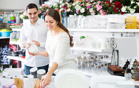 Couple buying ceramic ware in the shop Stock Photo