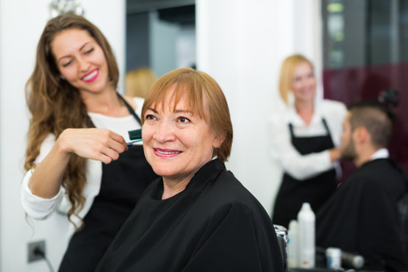 esthetics: Portrait of happy smiling senior woman at the hairdressing salon