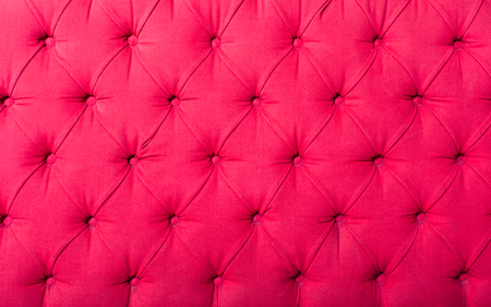 padding: Close up view on bright pink textile texture of sofa