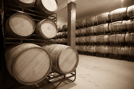 Vintage photo of old  winery  with  wooden barrels