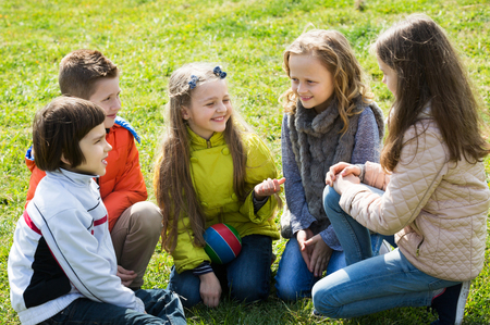 blabbing: Little kids chatting and having fun outdoor in sunny day