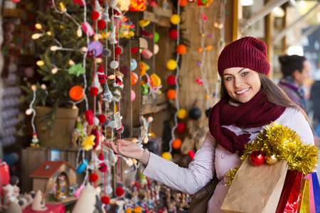 overspending: Portrait of female customer near counter with Christmas gifts Stock Photo