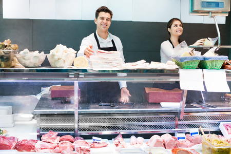 salo: Delicatessen store staff selling fresh-killed the meat and salo Stock Photo