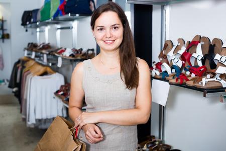 footgear: Portrait of pretty female in footgear store Stock Photo