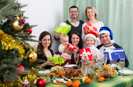 granny and grandad: Happy mature parents with they adult kids and grandchildren celebrating Merry Christmas Stock Photo