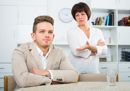 persuades: Mother calms the son and persuades him not to be upset