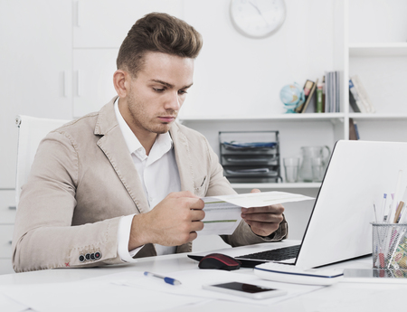 diligent: Portrait of diligent glad positive businessman working in modern office Stock Photo