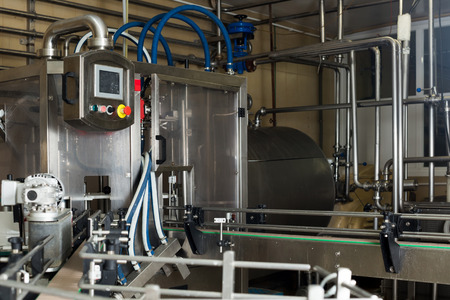 specialised: view on industrial dairy production gear on the milk factory