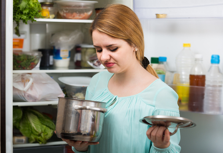 foul: Long-haired spanish woman noticed foul smell of food from casserole