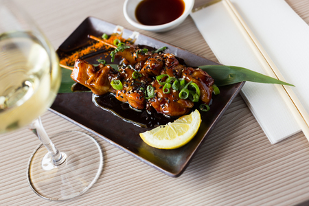 japanise dish with chicken yakitori served in the restaurant and ready to eat Stock Photo
