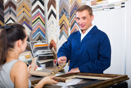 picture framing: ?american  man seller talking to customer in picture framing studio Stock Photo