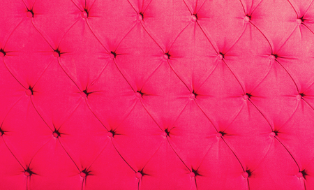 upholstered: pink upholstered textile backdrop with symmetric buttons