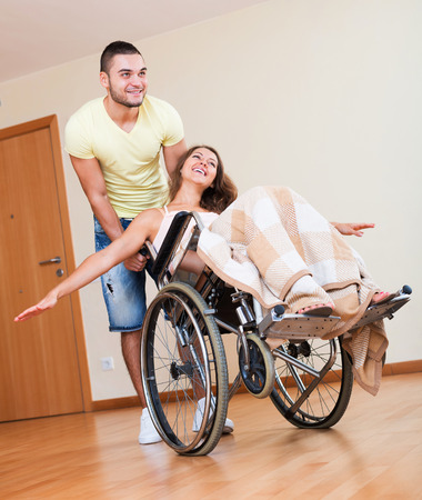 invalidity: Young man and woman who sitting on wheelchair