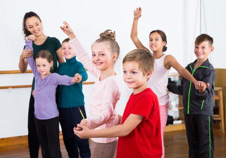 vigorous little boys and girls dancing pair dance in the ballet studio Stock Photo