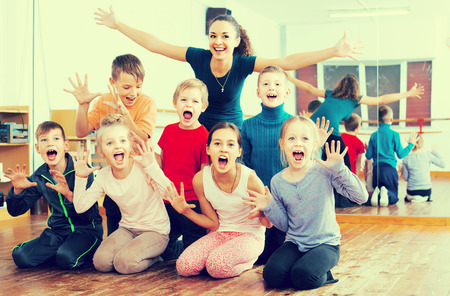 niÑos contentos: Glad children  in dance studio smiling and having fun Foto de archivo