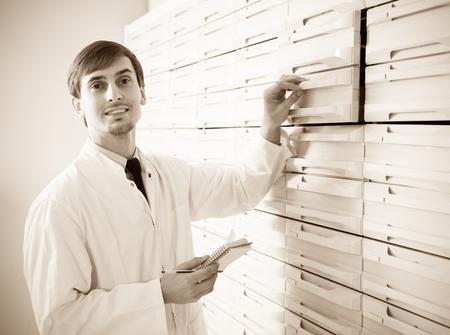 depot: Male pharmacist posing in pharmacy depot