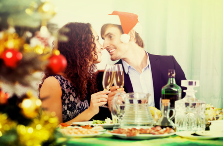 Young happy couple celebrate the New Year at home