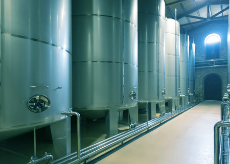 stell: Rows of contemporary  large stell barrels in winery factory