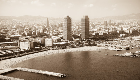 Summer beach with many people resting at Barcelona seaside in Catalonia, Spain