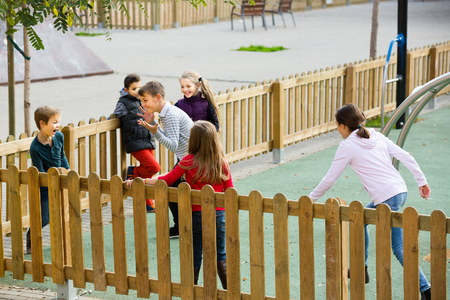 romp: Cheerful children playing romp game Touch-last at outdoor