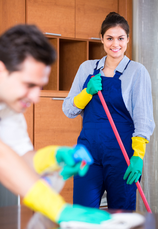 Portrait of cleaners with supplies working indoors