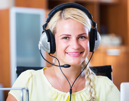 Portrait of happy beauty call center operator in office